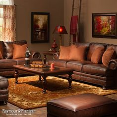 This room is the definition of a fall-like space! From the amber brown hues to the rustic style decor, you can't get much more seasonal than this. Start your rustic design with a cozy leather sofa like this one.