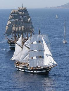 Square-rigged ship (background) with a hermaphrodite brigantine in the foreground