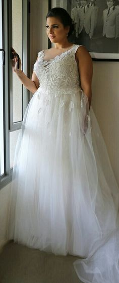 Plus size wedding gown with illusion neckline and a tulle skirt. Koral. Studio Levana