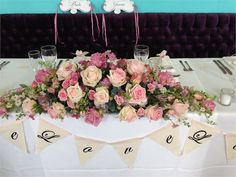 Beautiful mix of roses for this Top Table arrangement in the Ballroom at Walcot Hall.