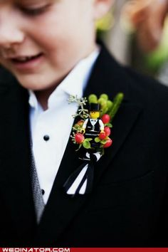This little lego boutonniere is quite possibly the cutest thing ever. I don't want to see it on an adult, but on this little boy..ADORABLE! :)