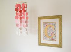 DIY ombre mobile - create using scrapbook paper and a circle punch! #nursery #DIY