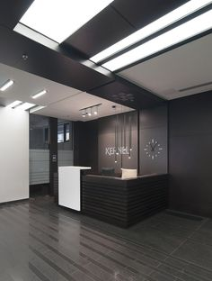 Black wooden panels for walls Office Reception Design, Office Table Design, Industrial Office Design, Office Interior Design, Office Decor, Reception Desks, Medical Office Design, Pharmacy Design, Corporate Interiors