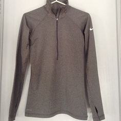 NWT Nike Pro Dri-Fit Grey Half Zip Jacket NWT Lightgrey Nike Pro Dri-fit Longsleeve Halfzip Jacket  with White Nike Swoosh on top right shoulder It includes thumb holes for working out The last picture is a model picture of this jacket except mine is darker and not speckled Nike Jackets & Coats