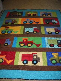 Where did you get the patterns for making the trucks, tractors and front loaders for this quilt. Description from sherimhoward.blog.... I searched for this on bing.com/images