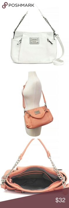 """Nicole by Nicole Miller Amber Shoulder Bag Features: Cell Phone Pocket, Interior Pockets, Top Zip, Accessory PocketMetal Color: Silver ToneOuter Surf Material: 100% PolyurethaneBag Features: Exterior CompartmentLining Material: PolyesterNumber of Pockets: 7Drop Length: 9 1/2 Inches  Lining Material: 100% Polyester Measurements: 9H x 13W x 4"""" D Closure Type: ZipperPockets: Front Zip Pocket, 2 Side Slip Pockets,  1 Inside Zip Pocket, 3 Inside Slip PocketsHandle Drop Length: 10 Inches Color is…"""