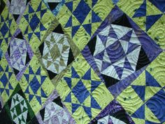 The piecing and circular quilting on this one is gorgeous.