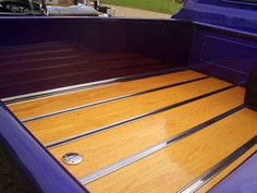1965 Custom Chevy truck with wood and chrome lined bed floor, built by Carlisle Customs & Classics.