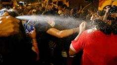 Hong Kong police use pepper spray in China oath-taking protest