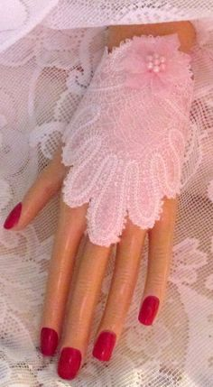 These lovely Bridal Fingerless Lace Gloves are an amazingly beautiful addition to the bridal ensamble. These are white with a pink satin lining, with a pretty pink bow. Not all of these are sold for the Bride but they may be used for the Brides Maids or for a special occasion, like Proms, or formal occasions.