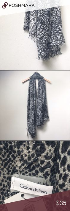 Calvin Klein Animal Print Scarf New with tags Calvin Klein animal print scarf. A beautiful addition to any closet! Calvin Klein Accessories Scarves & Wraps