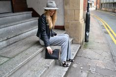 Ellen The Monochromes grey wool trousers leather jacket and fedora