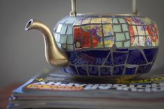 Such a cute brass and mosaic teapot!