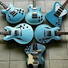 Classic Gibson electric guitars. All of them Pelham Blue.