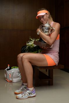 Maria Sharapova - 2014 French Open - Day Fourteen. Maria Sharapova of Russia poses with the Coupe Suzanne Lenglen trophy in her changing room following her victory in her women's singles final match against Simona Halep of Romania on day fourteen of the French Open at Roland Garros on June 7, 2014 in Paris, France.
