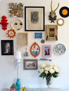 This makes me want to collect miss-matching photo frames and colourful wall hangings to achieve a similar look.