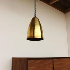 amazingly inexpensive Brass Shade Pendant Lamp: via Remodelista