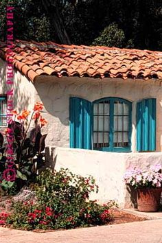 clay tile roof and stucco (great windows and shutters too)