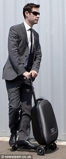 Forget running through the terminal to reach the next flight, jump on your suitcase scooter!  James Bond would approve.