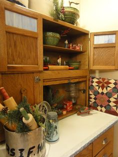 I love how she decorated her Hoosier cabinet. I WANT ONE!!!!