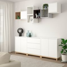 EKET Storage combination with legs, white/light gray. With the EKET series you can build your storage big, small, colorful or discreet to either display or hide your things. And if your space and needs change, you can easily change your EKET solution too. Ikea Eket, Ikea Hack, White Stain, Cube Storage, Ikea Storage, Ikea Living Room Storage, Storage Organizers, Home Furniture, Furniture Stores