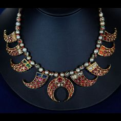 Mughal Indian Reversible Necklace, ca. 1900  on Antiques Roadshow. what the appraiser missed noting, probably because he is not familiar with Indian jewellery, is that this is also an unusual example of a 'navaratna' or 9 gems necklace. if you look carefully, you will find the tops of the jewelled tiger claws are set with 1 - ruby, 2 - corals, 3 - pearls, 4 - hessonite, 5 - blue sapphires, 6 - emeralds, 7 - yellow sapphires, 8 - cats-eyes and 9 - the central pendant is set with (uncut)…