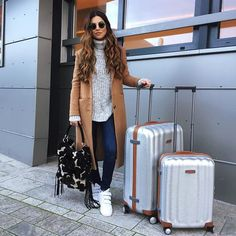 Pin for Later: The 1 Travel Essential Every Blogger Owns Negin Mirsalehi Negin Mirsalehi made a set out of her matching silver Samsonites.
