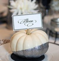 White pumpkins in glitter- could use for decorations, place settings...