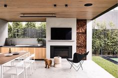 The perfect outdoor entertaining space. and I'll take one of the cute puppy too please 🐶 Brighton 5 by Styling… House Design, House, Outdoor Entertaining Area, Outdoor Entertaining Spaces, Outdoor Kitchen Design, New Homes, Outdoor Fireplace, Outdoor Design, Outdoor Kitchen