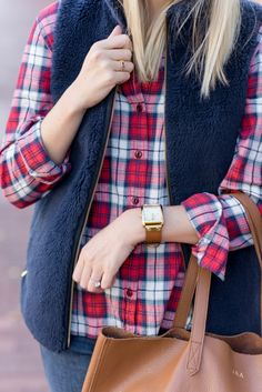 Plaid flannel + fleece vest in Boulder, CO.