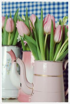 Pink tulips, pink-and-gilt French enamel chocolate pots, and gingham. Could you get more cheerful?