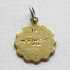 Thou shalt not kill vintage charm in gold color With the 5th Commandment written on one side and the reverse plain Ideal to add to a charm bracelet