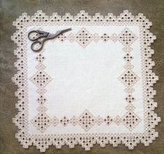 23% Doily on the table, hand-embroidered in the technique of Hardanger…