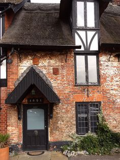 Horning, England UK- a 17th century cottage, you can just see the date above the door, 1695. The door is about 5 foot high.