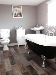 Jez from Portsmouth's beautiful Victorian style bathroom features the gorgeous black Shakespeare roll top bath complete with statement dragon feet from VictoriaPlumb.com. #VPShareYourStyle