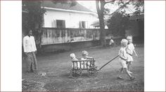 Children playing under the watch of their domestic helper or called baboe in colonial times.