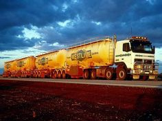 Volvo twin steer road train.