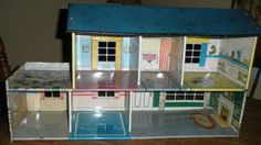 Vintage 1950's Marx Tin Split Level Doll House ...My sister had I had one just like this...A great memory!
