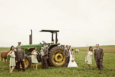 A green tractor makes for a unique photo opportunity in this farm wedding. Photo: Kelly Daniels