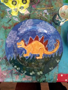 a dinosaur plate painted at Faux Arts in Marlborough, in a ceramic drop in