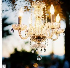 A crystal chandelier added a touch of elegance to the outdoor event.