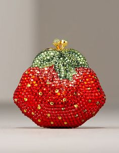 This delicious strawberry pillbox by Judith Leiber went for $595 at Neiman Marcus. Judith Leiber's hand-beaded crystal evening bags in whimsical, three-dimensional shapes—like ladybugs, cupcake...