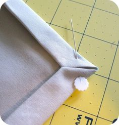 Great mitered corner tutorial...GOOD to use for single cloth hems and for backing fabric binding when using two cloth units.