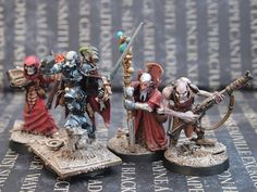 Inquisitor and henchmen.  From Ammo Bunker