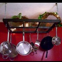 I am totally going to make this! Never thought to use an old window to hang my pots