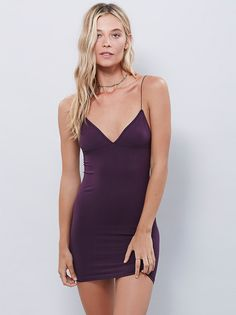 Skinny Strap Bodycon | Stretchy, seamless bodycon slip dress with plunging neckline. Thin non-adjustable straps. Sexy and simple, a great mid-length layering piece!