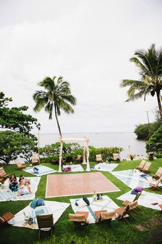 An artist couple from upstate New York host a relaxed, intimate and DIY backyard picnic-style wedding in Kauai, Hawaii. They spent a week with family and friends at an idyllic private estate on Anini Beach.