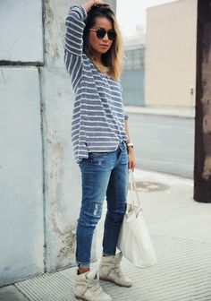Gray and white #striped sweater, blue jeans, white #boots, handbag. Street #women fashion outfit clothing style apparel @roressclothes closet ideas