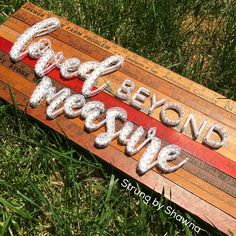 """Vintage yard sticks were adhered to a stained piece of wood. """"Loved Beyond Measure"""" […] Diy Arts And Crafts, Craft Stick Crafts, Crafts To Sell, Wood Crafts, Craft Gifts, String Art Diy, Ruler Crafts, Yard Sticks, Stick Art"""