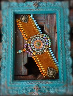 I love the colors in this. Native tribal LEATHER CUFF BRACELET Mandala Flower charm by GPyoga, $63.00